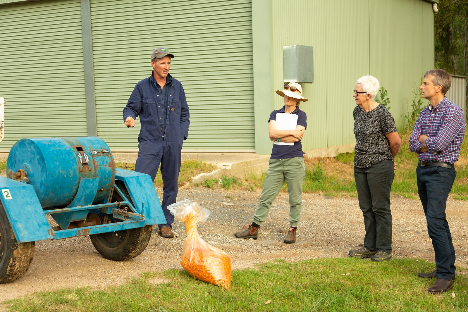Biosecurity officer talks to landholders about group rabbit control